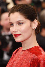Laetitia Casta slicked her hair back into a simple bun for the Met Gala.