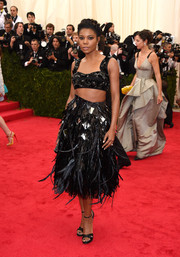 Gabrielle Union added more fanciful flair with a black feather skirt, also by Prada.