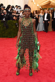Always bold on the red carpet, Lupita Nyong'o pulled off this bauble and feather-embellished net dress by Prada during the Met Gala.