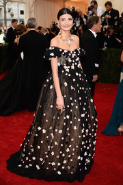 Giovanna Battaglia looked heavenly in a flower-appliqued off-the-shoulder gown by Dolce & Gabbana during the Met Gala.