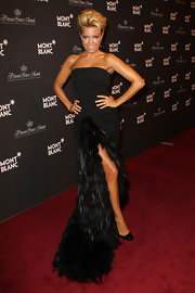 Sylvie van der Vaart looked fierce as she arrived on the Montblanc red carpet in an avant garde black feather gown by Viktor & Rolfe.
