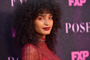 Indya Moore wore her hair in tight curls at the 'Pose' red carpet event.