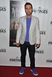 Lance Bass' purple top popped when he paired it with a cream blazer at the 'Jekyll & Hyde' red carpet in NYC.