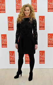 Kelly struck a pose in black lace-up ankle boots. She donned the boots with monochromatic black attire.
