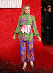 Tallia Storm went all out with the colors pairing her green blouse with purple print pants, also by Gucci.