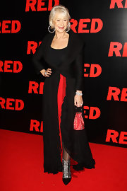 Actress Helen Mirren  arrived at the UK film premiere of Red at the Royal Festival Hall wearing a red Swarovski crystal hoop handle clutch.