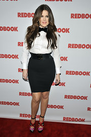 Khloe gets playful on the red carpet with a black bowtie and white button-up.