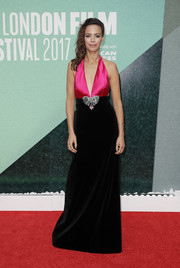 Berenice Bejo worked a plunging Gucci halter gown, in pink satin and black velvet with a crystal bow accent, at the BFI London Film Festival premiere of 'Redoubtable.'