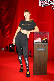 Gigi Hadid was sporty-sexy in a black crop-top by Reebok at the Future Nostalgia party.