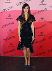 Hannah Simone attended the 29Rooms Los Angeles 2018 wearing a navy velvet dress with flutter sleeves and a flared hem.