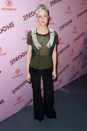 Andrea Riseborough styled her shirt with a shell-adorned vest.