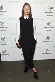 Cara Santana layered a loose black jumpsuit over a collared shirt for the 29Rooms event.
