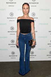 Catt Sadler completed her outfit with on-trend flare jeans.