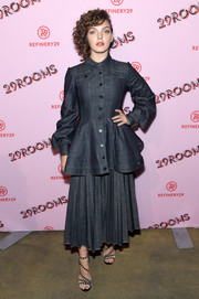 Camren Bicondova hit the 29Rooms: Turn It Into Art event wearing a blue denim peplum jacket.