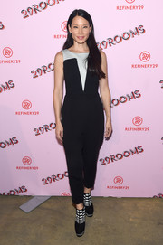 Lucy Liu coordinated her jumpsuit with some funky checkered boots.