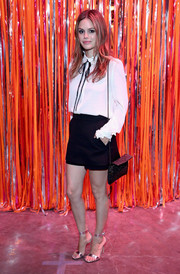 Rachel Bilson teamed a dotted chain-strap bag with a white blouse and a black skort for the 29Rooms: Turn It Into Art event.