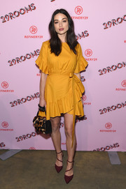 Crystal Reed paired her mustard dress with strappy plum pumps by Aldo for a stylish color contrast.