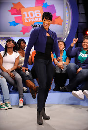 Regina King was in fine form in gray ankle boots, skinnies, and a cropped jacket during a visit to '106 & Park.'
