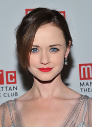 Alexis Bledel arrived for the opening night of 'Regrets' on Broadway wearing a rich matte red lipstick.