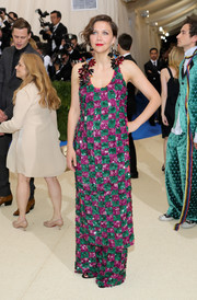 Maggie Gyllenhaal made a vibrant choice with this heavily embellished tunic and wide-leg pants combo by Marni for the 2017 Met Gala.