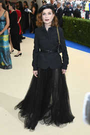 Isabelle Huppert softened her look with a sheer black maxi skirt, also by Dior.