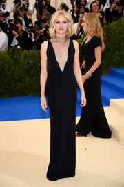 Naomi Watts was all about edgy glamour at the 2017 Met Gala in a black Stella McCartney column dress with a metallic mesh bib.