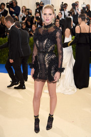 Lara Stone was sexy-goth in a little black lace dress by Christopher Kane at the 2017 Met Gala.
