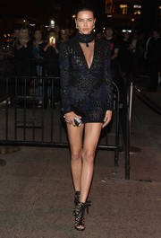 Adriana Lima worked her supermodel figure in a skintight blue mini dress by Nicolas Jebran at the Met Gala after-party.