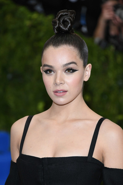 Hailee Steinfeld slicked her hair up into an elaborate top knot for the 2017 Met Gala.
