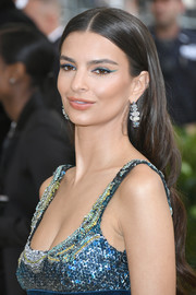 Emily Ratajkowski finished off her perfectly coordinated look with a pair of gemstone hoop earrings.