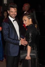 Ruth Negga arrived for the Met Gala after-party carrying a Valentino Rockstud clutch, in black.