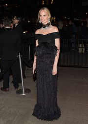 Lauren Santo Domingo looked resplendent in a feathered off-the-shoulder gown by Proenza Schouler at the Met Gala after-party.