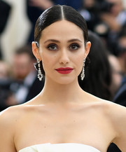Emmy Rossum sported a perfectly sculpted chignon at the 2017 Met Gala.