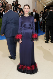 Sarah Paulson donned a sleek, sophisticated navy Prada gown with a feathered hem and cuffs for the 2017 Met Gala.