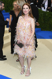 A pair of collared white sandals finished off Julianne Moore's outfit.