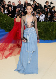 Liu Wen flashed some flesh at the 2017 Met Gala in a sheer Off-White top with strategically placed beading.