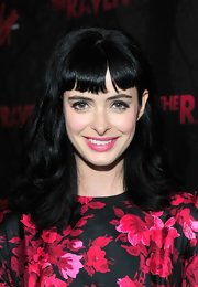 Krysten Ritter wore her glossy black tresses in soft waves with short bangs at the premiere of 'The Raven.'