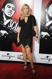 Shannon Tweed teamed up her top with a black mini skirt with a sequined trim detail.