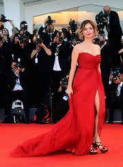 Violante Placido blew us away in her soft yet striking red gown at the Venice Film Festival.
