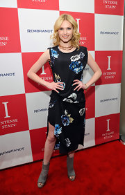 Claudia Lee struck a pose on the red carpet of the Rembrandt party wearing this draped floral dress.