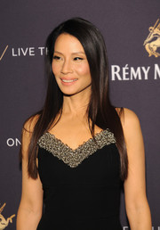 Lucy Liu left her hair loose in a straight, side-parted style for the One Life/Live Them event.
