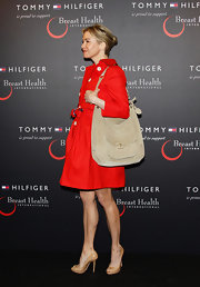 Renee Zellweger carried a sophisticated tan suede shoulder bag to the Tommy Hilfiger Limited Edition Bag launch.