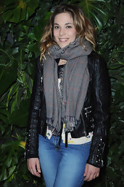 Alysson bundles up in a thick plaid scarf for the Replay Flagship Opening.