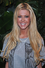 Tara Reid showed off her long blond tresses while attending a cocktail party in Paris, France.