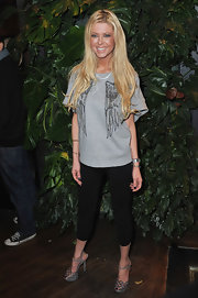 Tara Reid matched her wing emblazoned tee to gray Sergio Rossi Half Cage platform sandals. The heels were a glam choice for an otherwise casual look.