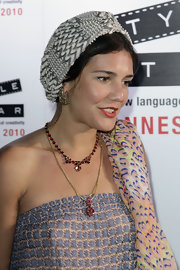 Margherita Missoni sported a mishmash of prints with this turban, scarf, and jumpsuit combo at the Replay party in Cannes.