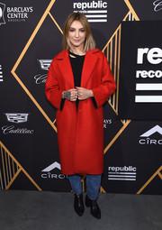 Julia Michaels teamed a red wool coat with a black shirt and blue jeans for the Republic Records Grammy celebration.