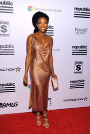 Brandy was vintage-chic in a copper-hued cowl-neck dress by CD Greene at the Republic Records Grammy celebration.