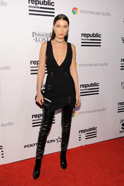 Black thigh-high boots completed Bella Hadid's fierce ensemble.