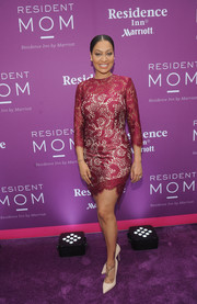 La La Anthony sheathed her curves in a burgundy lace mini dress for the Red Cross Moms celebration.